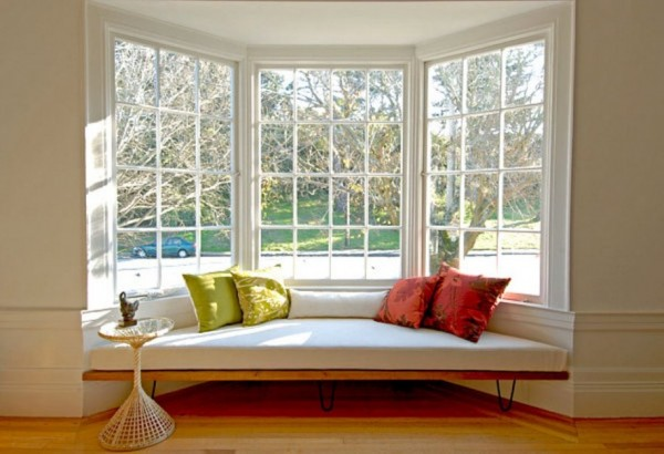 Simple-Comfy-Sofa-Which-Has-Red-And-Orange-Pillows-Perfected-By-Single-Ceramic-Table-For-Wonderful-Design-Of-Window-Seat-Built-In-Best-Design-Ideas