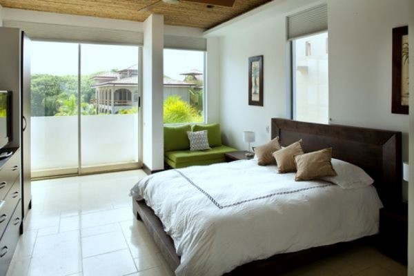 beach-bathroom-idea-in-white-clean-bathroom-color-and-fresh-green-sofa-in-the-corner-and-large-glass-window-for-outside-view