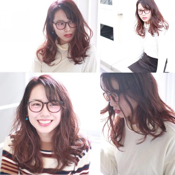 赤みのあるカラーと、ルーズな毛先のかわいいスタイル。くせ毛風のスタイルでもカラーの色味が違うと印象が変わりますね。少しボサッと仕上げた感じと、メガネの相性もいいですね。