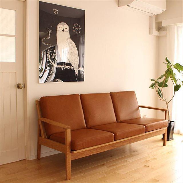 木製フレームのレザーソファ