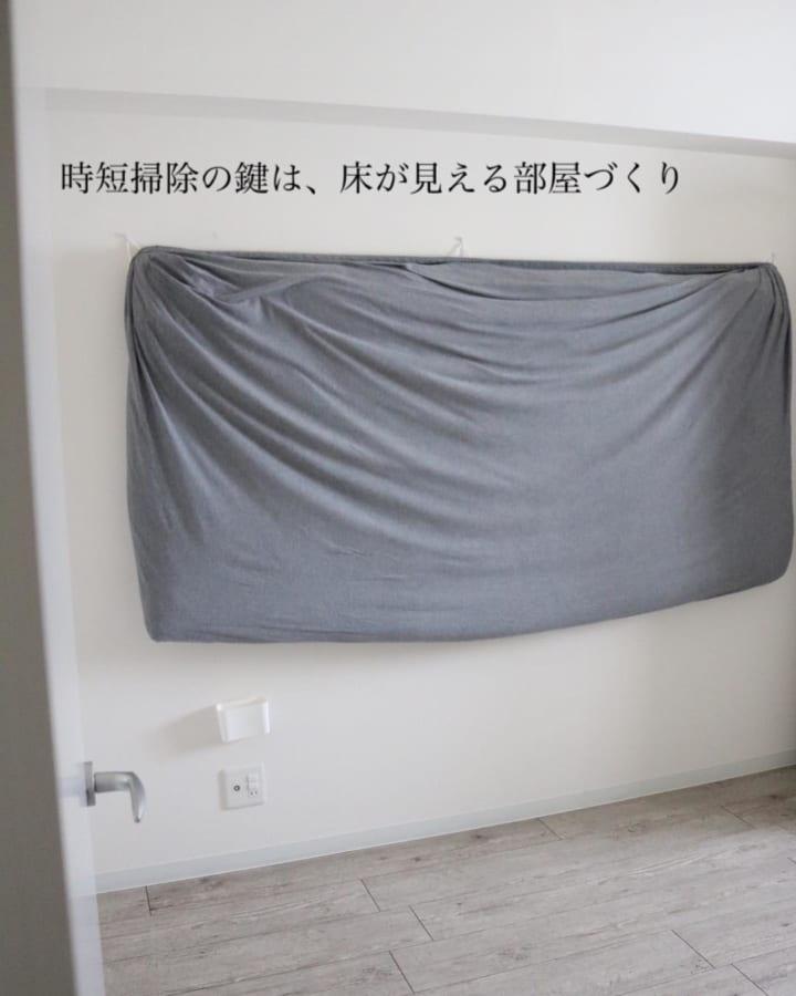 なんとお布団も壁に!