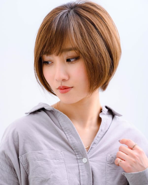 きれいな丸いシルエットが特徴の髪型に
