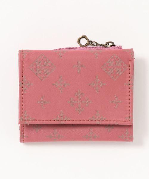 女性らしいピンクとアイコン柄が目立つミニ財布