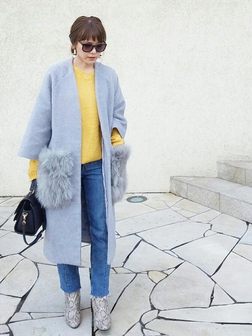 洗練ファッション◎黄色ニット×ブルーデニム
