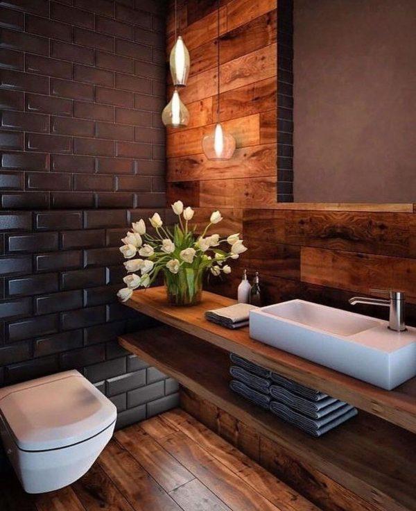 ブラックタイル×ウッドのシックなトイレ