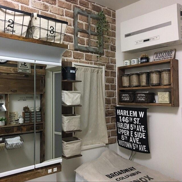 ダークブラウンのレンガで外国風の洗面所