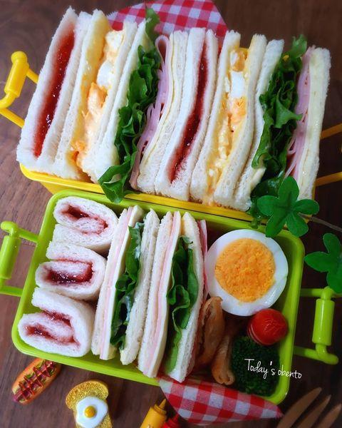 サンドイッチ、お弁当、ゆでたまご、春巻き、ジャムサンド、ハム、チーズ、レタス。